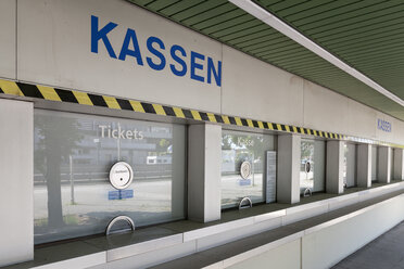 Germany, Berlin, view to row of closed ticket counters of trade fair - WI001064