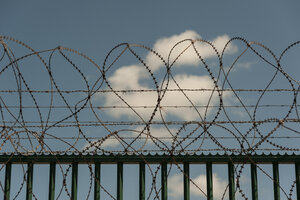 France, Nord-Pas-de-Calais, Dunkirk, part of barbed wire fence in front of a cloud - PAF000927