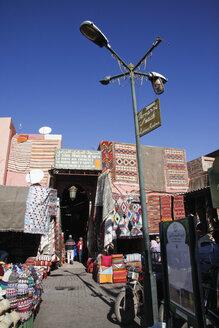 Morocco, Marrakesh, rugs on souk - RIM000305