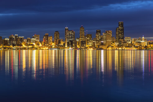 USA, Washington State, Puget Sound and skyline of Seattle at blue hour - FOF007119