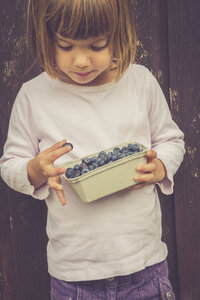 Little girl with box of blueberries - LVF002065