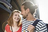 Germany, Berlin, Young couple walking in street - FKF000650