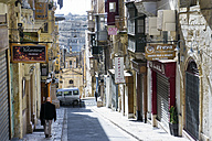 Malta, Valletta, alley in old town with closed shops on Sunday - WEF000250