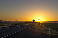 Australia, Queensland, road with mountain chain at sunrise - PUF000093