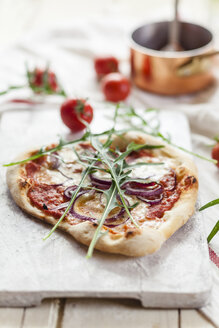 Homemade pizza on chopping board - SBDF001262