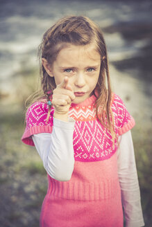 Portrait of little girl pointing at viewer - SARF000862
