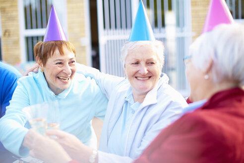 Senior friends on a birthday garden party - ZEF001039