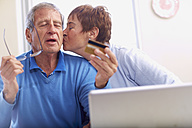 Senior couple shopping online at home - ZEF001074