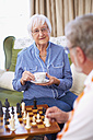 Senior couple playing chess and drinking coffee - ZEF001097