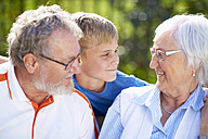 Grandparents with grandson outdoors - ZEF001137