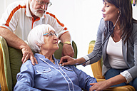 Medic caring for senior woman at home - ZEF001168