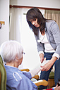 Medic caring for senior woman at home - ZEF001175