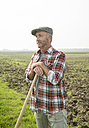 Farmer standing in front of a field - UUF002015