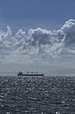 Spain, Andalusia, Tarifa, cargo ship on the ocean - KBF000182