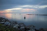 Slovenia, Istria, Slovene Littoral, Izola, Adriatic coast at sunset - WIF001108