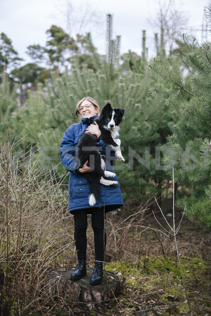 Germany, woman with Border Collie - DWF000193