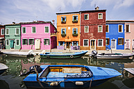 Italy, Veneto, Venice, Burano, Colourful houses by the canal - THAF000632