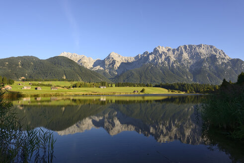 Germany, Bavaria, Upper Bavaria, near Klais, Lake Schmalsee with Karwendel mountains in background - LHF000412