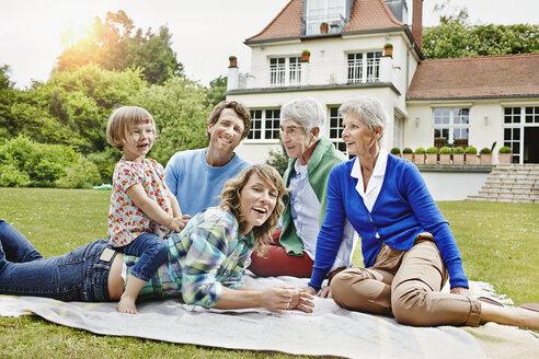 Germany, Hesse, Frankfurt, Three generations family in front of villa - RORF000077