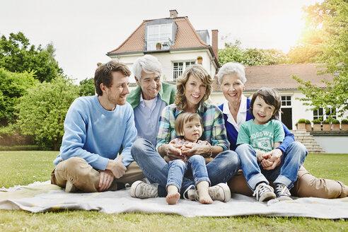 Germany, Hesse, Frankfurt, Three generations family in front of villa - RORF000079