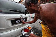 Malaysia, monk blessing new car - DSG000290