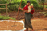 Myanmar, working mother carrying child on back - DSG000340