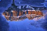 Spain, Ordesa National Park, Mondarruego Massif reflected in a puddle - DSGF000429