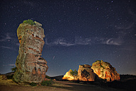 Spain, Castille-La Mancha, Chequilla, Rock formations under starry sky - DSGF000551