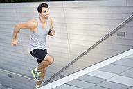 Sportsman jogging upstairs - MAD000059