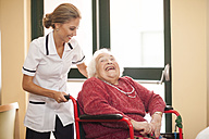 Nurse caring for senior woman in wheelchair - ZEF001318