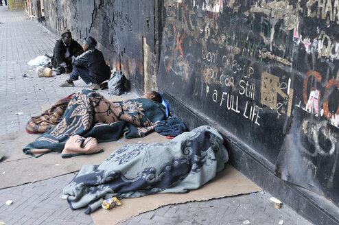 South Africa, Johannesburg, Hillbrow, street kids sleeping on pavement - FLK000492