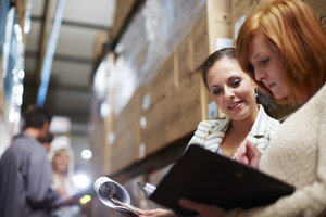 Two women with clipboard in warehouse - ZEF001442