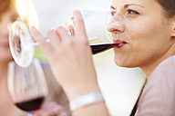 Woman drinking glass of red wine - ZEF001487