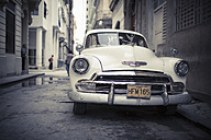 Cuba, parking white vintage car on a road - NN000034