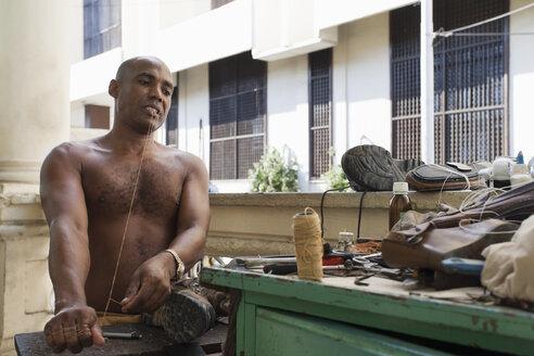 Cuba, Santiago de Cuba, cobbler at work - NN000076