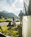 Austria, Tyrol, Tannheimer Tal, two young  hikers relaxing - UUF002106
