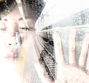 Face of Asian woman with closed eyes and japanese train station, double exposure - FL000523