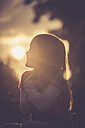 Silhouette of little girl at evening backlight - SARF000887