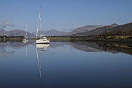 UK, Scotland, Highlands, Glen Coe, sailing boat on lake - DLF000016