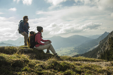 Austria, Tyrol, Tannheimer Tal, young couple resting on hiking tour - UUF002260