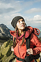 Austria, Tyrol, Tannheimer Tal, young woman looking up - UUF002214