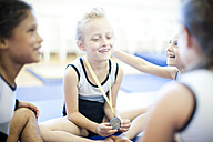 Happy young gymnasts with medal - ZEF002005