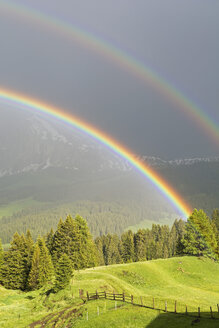 Italy, South Tyrol, Seiser Alm, Double Rainbow in front of Langkofel - UMF000730