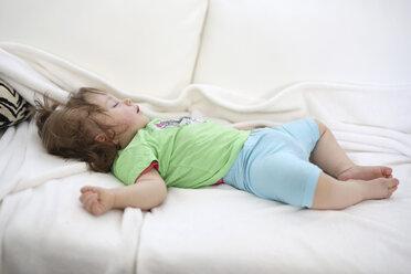 Baby girl sleeping on white blanket - SHKF000011