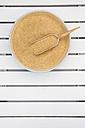 Bamboo bowl and wooden shovel of organic amaranth, Amaranthus, on white wood - LVF002044