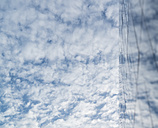 Clouds mirroring in a glass facade of high-rise building - OPF000015