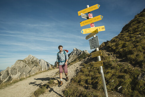 Austria, Tyrol, Tannheimer Tal, young man hiking on mountain trail - UUF002163