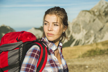 Austria, Tyrol, Tannheimer Tal, young woman on a hiking trip - UUF002161
