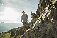 Austria, Tyrol, Tannheimer Tal, young couple hiking at rocks - UUF002150