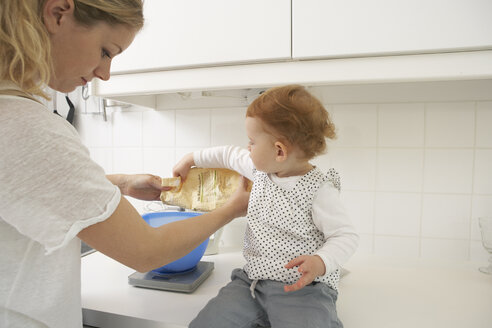 Mother and little daughter baking cake together - FSF000236